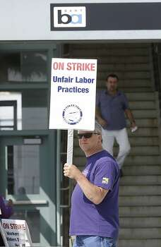 Bay Area Rapid Transit maintenance worker Doug Isonio pickets outside of a station in Millbrae, Calif., Monday, July 1, 2013. Early Monday, July 1, 2013, two of San Francisco Bay Area Rapid Transit's largest unions went on strike after weekend talks with management failed to produce a new contract. (AP Photo/Jeff Chiu) Photo: Jeff Chiu, Associated Press