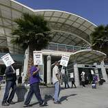 Bay Area Rapid Transit workers picket outside of a station in Millbrae, Calif., Monday, July 1, 2013. Early Monday, July 1, 2013, two of San Francisco Bay Area Rapid Transit's largest unions went on strike after weekend talks with management failed to produce a new contract. (AP Photo/Jeff Chiu)