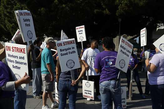 Picketers stand outside of the West Oakland BART station during strikes against BART in Oakland, Calif. on July 1, 2013. Photo: Ian C. Bates, The Chronicle