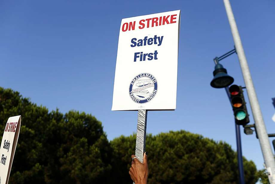 During the BART strike early in July, a picketer on the line in Oakland raises a sign. Photo: Ian C. Bates, The Chronicle