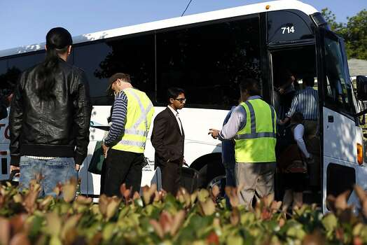 BART riders board a bus commissioned by BART to San Francisco during strikes against BART outside of the West Oakland BART station in Oakland, Calif. on July 1, 2013. Photo: Ian C. Bates, The Chronicle