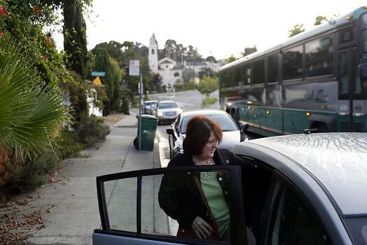 Leann Love gets into a vehicle in a casual carpool lane during strikes against BART in Oakland, Calif. on July 1, 2013. Love usually takes the BART system to work. Photo: Ian C. Bates, The Chronicle