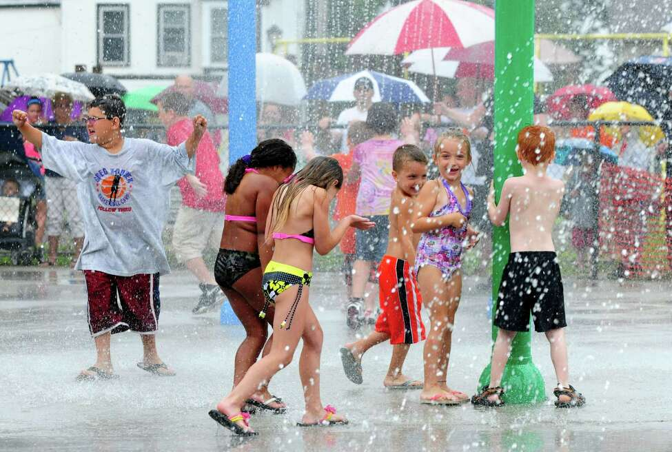 Children revel under waters of Green Island's new spray park at the Paine Street Park Monday morning, July 1, 2013, in Green Island, N.Y. (Will Waldron/Times Union)