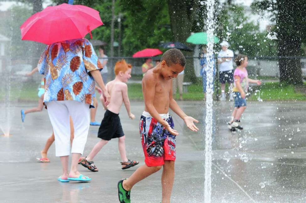 Jayden Johnson, 7, enters the new Green Island new spray park for the first time at the Paine Street Park Monday morning, July 1, 2013, in Green Island, N.Y. (Will Waldron/Times Union)