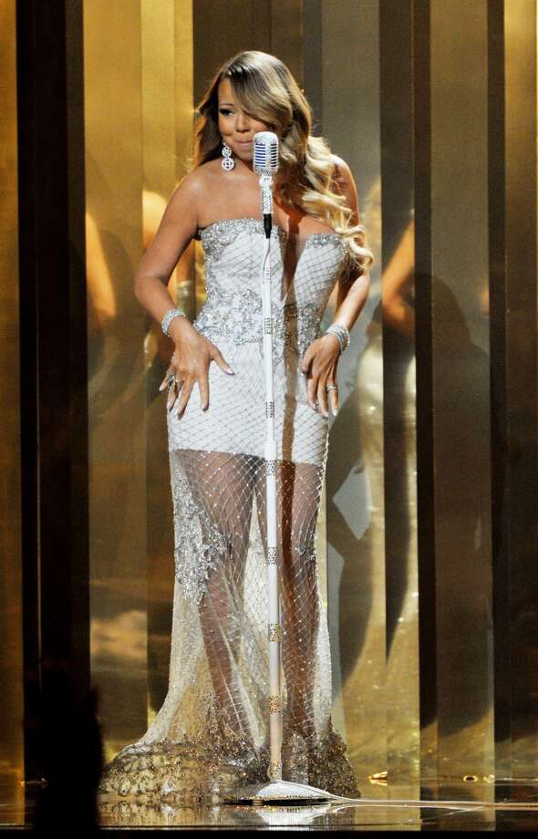 LOS ANGELES, CA - JUNE 30:  Singer Mariah Carey onstage during the 2013 BET Awards at Nokia Theatre L.A. Live on June 30, 2013 in Los Angeles, California.  (Photo by Kevin Mazur/Getty Images for BET)