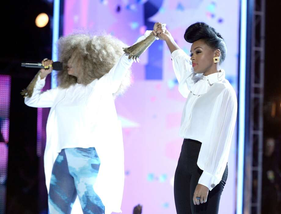 LOS ANGELES, CA - JUNE 30:  Singers Erykah Badu and Janelle Monae perform onstage during the 2013 BET Awards at Nokia Theatre L.A. Live on June 30, 2013 in Los Angeles, California.  (Photo by Kevin Winter/Getty Images for BET)