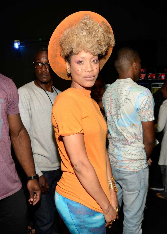 LOS ANGELES, CA - JUNE 30:  Recording artist Erykah Badu poses backstage during the 2013 BET Awards at Nokia Theatre L.A. Live on June 30, 2013 in Los Angeles, California.  (Photo by Kevin Mazur/BET/Getty Images for BET)