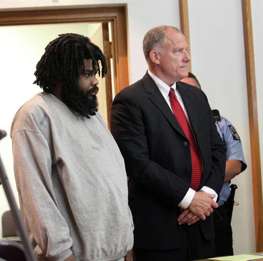 "Tyree Smith, left,  stands with public defender Joseph Bruckmann on the first day of trial before a three judge panel in Bridgeport, Conn.  on Monday, July 1, 2013. Smith is charged with the murder of Angel ""Tun Tun"" Gonzalez. Photo: BK Angeletti, B.K. Angeletti / Connecticut Post freelance B.K. Angeletti"
