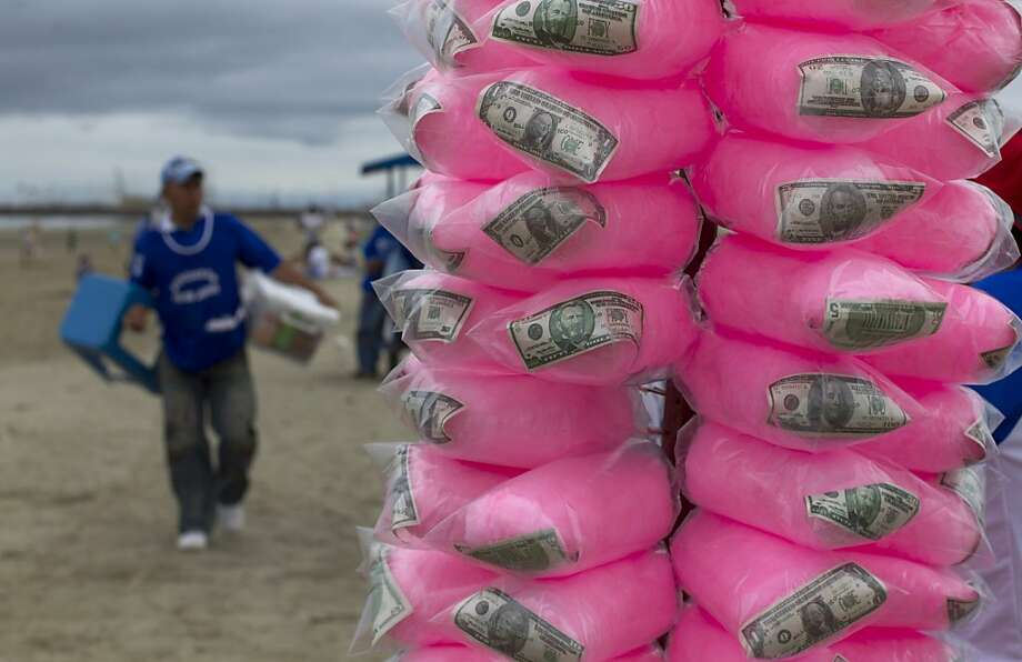 If you eata lot of cotton candy on this beach in Manta, Ecuador, you'll get rich! Photo: Martin Mejia, Associated Press