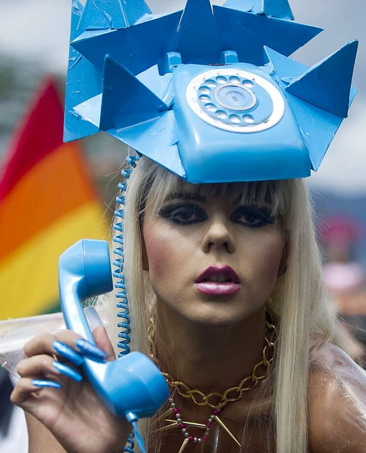It's for you: Some revelers wore headphones during the Gay Pride Parade in Medellin, 