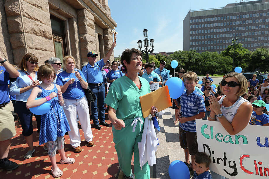 Senator Donna Campbell, center, addresses supporters of the Texas legislation abortion bill at the State Capitol for the start of  the second special session, Monday, July 1, 2013. Photo: Jerry Lara, San Antonio Express-News / ©2013 San Antonio Express-News