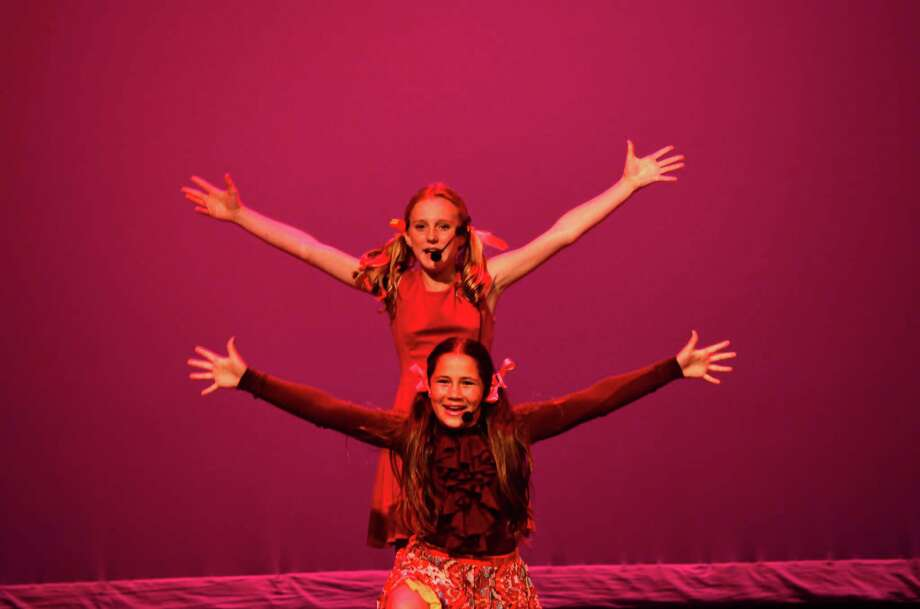 "Haley Strom (top) and Katharine Glassmeyer, fifth graders from the Pear Tree Point School, performed ""If Mama was Married"" from Broadway's ""Gypsy."" Photo: Megan Spicer"
