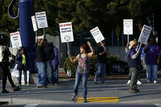 Michelle Collin, center, cheers as passing cars honk during strikes against BART outside of the West Oakland BART station in Oakland, Calif. on July 1, 2013. Photo: Ian C. Bates, The Chronicle