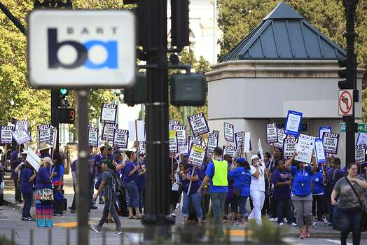 SEIU 1021 union members comprised of BART and City of Oakland workers on strike today at Frank Ogawa Plaza on Monday July 1, 2013 in Oakland, Calif. Workers say they are protesting unfair labor practices and demand greater investment in critical public services. Photo: Mike Kepka, The Chronicle