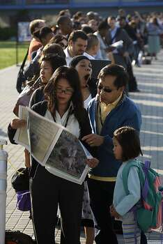 Quynh Tran (front left) takes the ferry for the first time going to the Exploratorium for work, as her husband Anthony Nguyen needs to go to work at the Presidio and will drop off their daughter Quynh-Anh Nguyen, 7 years old, at summer camp at Crissy Field as they line up for the ferry service at Jack London Square in Oakland, Calif., while the City of Oakland and BART workers officially go on strike on Monday, July 1, 2013. Photo: Liz Hafalia, The Chronicle