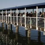 Commuters coming off and lining up for the ferry service at Jack London Square as City of Oakland and BART workers officially go on strike in Oakland, Calif.,  on Monday, July 1, 2013.