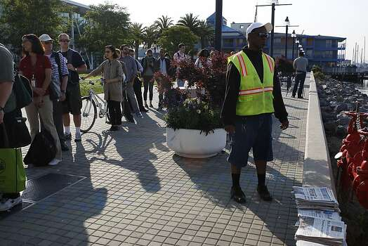Commuters lining up for the ferry service at Jack London Square as City of Oakland and BART workers officially go on strike in Oakland, Calif.,  on Monday, July 1, 2013. Photo: Liz Hafalia, The Chronicle