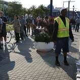 Commuters lining up for the ferry service at Jack London Square as City of Oakland and BART workers officially go on strike in Oakland, Calif.,  on Monday, July 1, 2013.