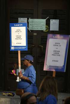 A notice taped on the front door of city hall as City of Oakland and BART workers officially go on strike in Oakland, Calif.,  on Monday, July 1, 2013. Photo: Liz Hafalia, The Chronicle