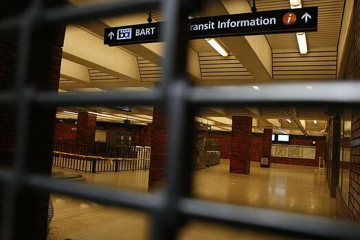 Gates are closed today at the BART station on Broadway @ 14th streets as BART workers officially go on strike in Oakland, Calif.,  on Monday, July 1, 2013. Photo: Liz Hafalia, The Chronicle