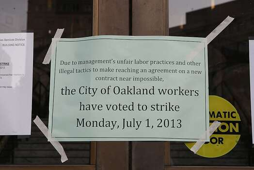 A notice taped to the front door of city hall as City of Oakland and BART workers officially go on strike in Oakland, Calif.,  on Monday, July 1, 2013. Photo: Liz Hafalia, The Chronicle
