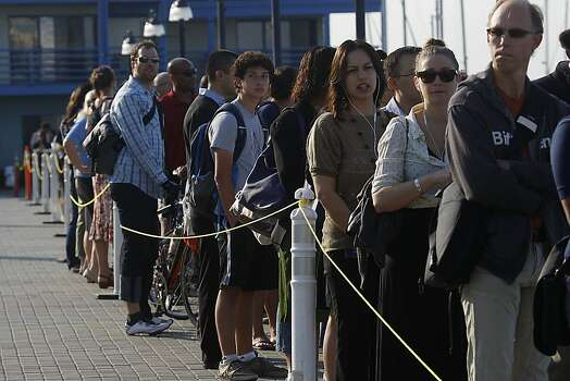 Commuters line up for the ferry service at Jack London Square as City of Oakland and BART workers officially go on strike in Oakland, Calif.,  on Monday, July 1, 2013. Photo: Liz Hafalia, The Chronicle