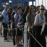 Commuters line up for the ferry service at Jack London Square as City of Oakland and BART workers officially go on strike in Oakland, Calif.,  on Monday, July 1, 2013.
