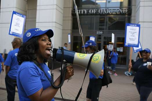 Carla Reed (left) leads union members in chants as City of Oakland and BART workers officially go on strike in Oakland, Calif.,  on Monday, July 1, 2013. Photo: Liz Hafalia, The Chronicle