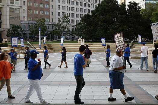 Union members and supporters protest in front of city hall as City of Oakland and BART workers officially go on strike in Oakland, Calif.,  on Monday, July 1, 2013. Photo: Liz Hafalia, The Chronicle