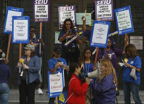 Union members protest in front of city hall as City of Oakland and BART workers officially go on strike in Oakland, Calif.,  on Monday, July 1, 2013. Photo: Liz Hafalia, The Chronicle