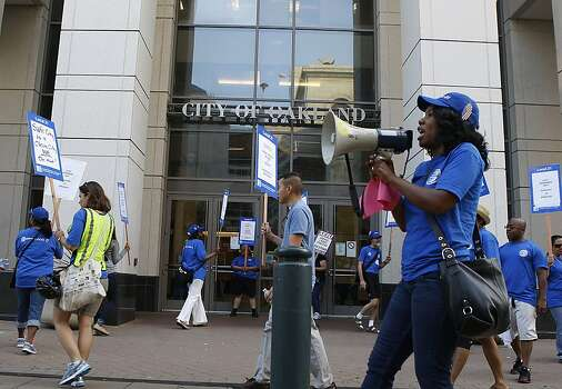 Carla Reed (right) leads union members in chants as City of Oakland and BART workers officially go on strike in Oakland, Calif.,  on Monday, July 1, 2013. Photo: Liz Hafalia, The Chronicle