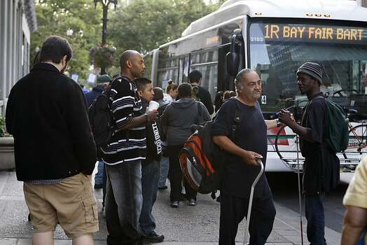 Commuters use alternate transportation as the City of Oakland and BART workers officially go on strike in Oakland, Calif.,  on Monday, July 1, 2013. Photo: Liz Hafalia, The Chronicle