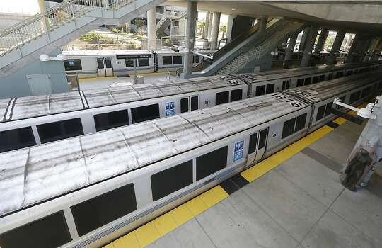 Bay Area Rapid Transit trains are shown sitting on the platform at the station in Millbrae, Calif., Monday, July 1, 2013. Early Monday, two of San Francisco Bay Area Rapid Transit's largest unions went on strike after weekend talks with management failed to produce a new contract. (AP Photo/Jeff Chiu) Photo: Jeff Chiu, Associated Press