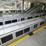 Bay Area Rapid Transit trains are shown sitting on the platform at the station in Millbrae, Calif., Monday, July 1, 2013. Early Monday, two of San Francisco Bay Area Rapid Transit's largest unions went on strike after weekend talks with management failed to produce a new contract. (AP Photo/Jeff Chiu)
