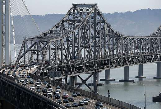 SAN FRANCISCO, CA - JULY 01:  Commuter traffic moves across the eastern span of the San Francisco-Oakland Bay Bridge on July 1, 2013 in San Francisco, California. Hundreds of thousands of San Francisco Bay Area commuters are scrambling to find ways to work after two of San Francisco Bay Area Rapid Transit's (BART)largest unions  went on strike at midnight after contract negotiations with management fell apart on Sunday. Train operators, mechanics, station agents and maintenance workers are seeking a five percent wage increase and are fighting management who want to have workers to begin contributing to their pensions, pay more for health insurance and reduce overtime expenses.  (Photo by Justin Sullivan/Getty Images) Photo: Justin Sullivan, Getty Images