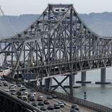 SAN FRANCISCO, CA - JULY 01:  Commuter traffic moves across the eastern span of the San Francisco-Oakland Bay Bridge on July 1, 2013 in San Francisco, California. Hundreds of thousands of San Francisco Bay Area commuters are scrambling to find ways to work after two of San Francisco Bay Area Rapid Transit's (BART)largest unions  went on strike at midnight after contract negotiations with management fell apart on Sunday. Train operators, mechanics, station agents and maintenance workers are seeking a five percent wage increase and are fighting management who want to have workers to begin contributing to their pensions, pay more for health insurance and reduce overtime expenses.  (Photo by Justin Sullivan/Getty Images)