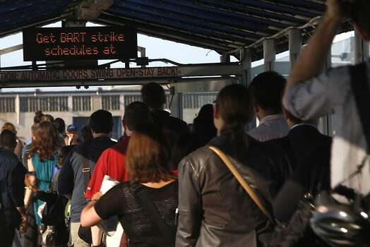 Commuters coming off and lining up for the ferry service at Jack London Square as City of Oakland and BART workers officially go on strike in Oakland, Calif.,  on Monday, July 1, 2013. Photo: Liz Hafalia, The Chronicle