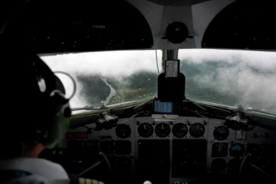 Sadelca airline Captain Ricardo Fajardo approaches the town of Miraflores, Colombia, in his DC-3 in 2012. Photo: Carlos Villalon, For The Washington Post / Carlos Villalon