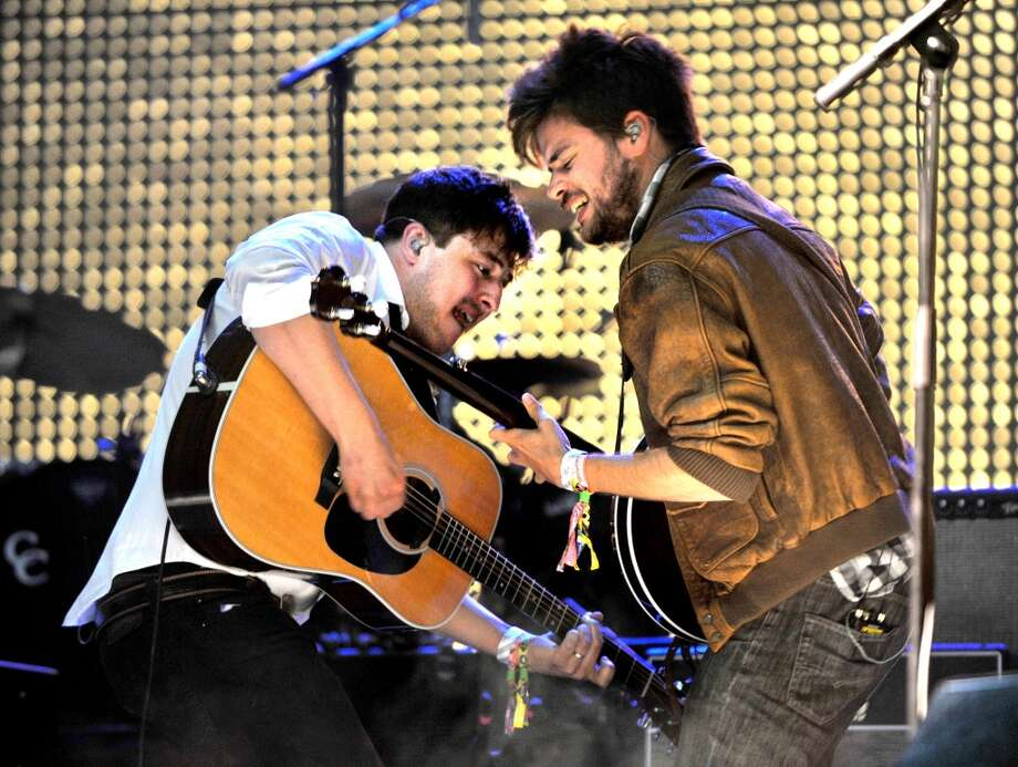 GLASTONBURY, ENGLAND - JUNE 30:  Marcus Mumford and Winston Marshall of Mumford and Sons perform headlining the Pyramid Stage at day 4 of the 2013 Glastonbury Festival at Worthy Farm on June 30, 2013 in Glastonbury, England.  (Photo by Shirlaine Forrest/WireImage)
