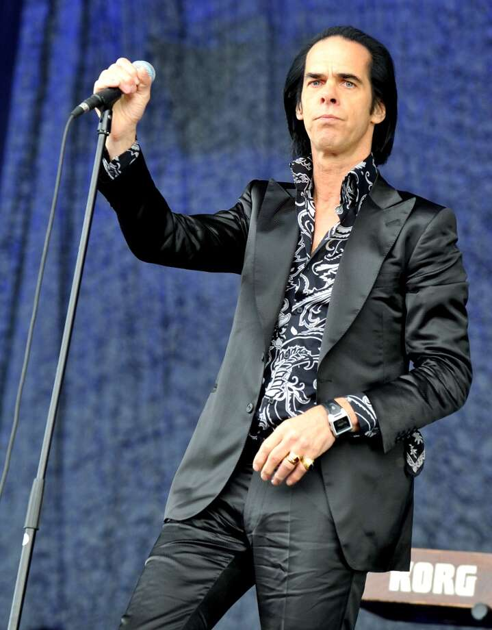 GLASTONBURY, ENGLAND - JUNE 30:  Nick Cave of Nick Cave and the Bad Seeds performs at day 4 of the 2013 Glastonbury Festival at Worthy Farm on June 30, 2013 in Glastonbury, England.  (Photo by Shirlaine Forrest/WireImage)