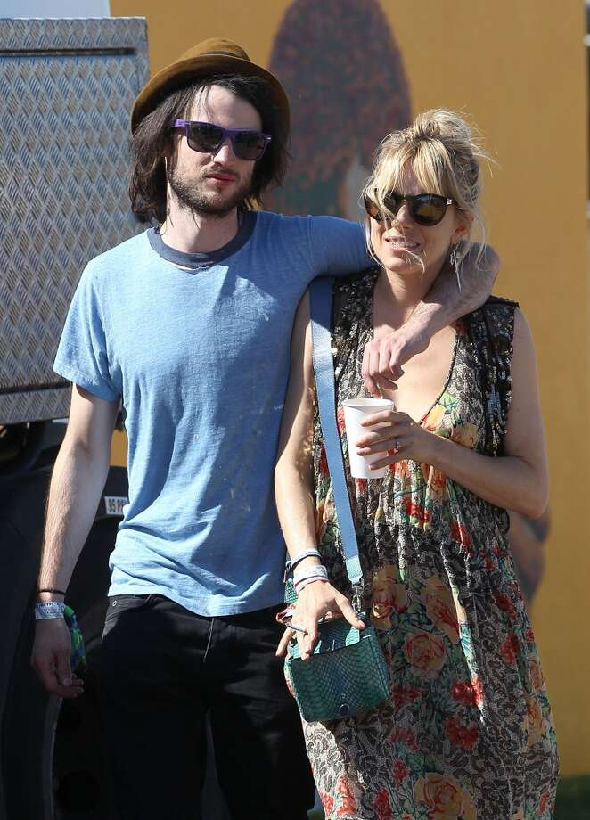 GLASTONBURY, ENGLAND - JUNE 29:  Sienna Miller and Tom Sturridge attend day 3 of the 2013 Glastonbury Festival at Worthy Farm on June 29, 2013 in Glastonbury, England.  (Photo by Danny Martindale/WireImage)