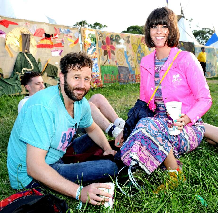 GLASTONBURY, ENGLAND - JUNE 29:  Actor Chris O'Dowd and wife television presenter Dawn Porter pose backstage during at day 3 of the 2013 Glastonbury Festival at Worthy Farm on June 29, 2013 in Glastonbury, England.  (Photo by Shirlaine Forrest/WireImage)