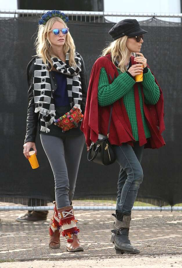 GLASTONBURY, ENGLAND - JUNE 30:  Sienna Miller and Poppy Delevingne atend day 4 of the 2013 Glastonbury Festival at Worthy Farm on June 30, 2013 in Glastonbury, England.  (Photo by Danny Martindale/WireImage)