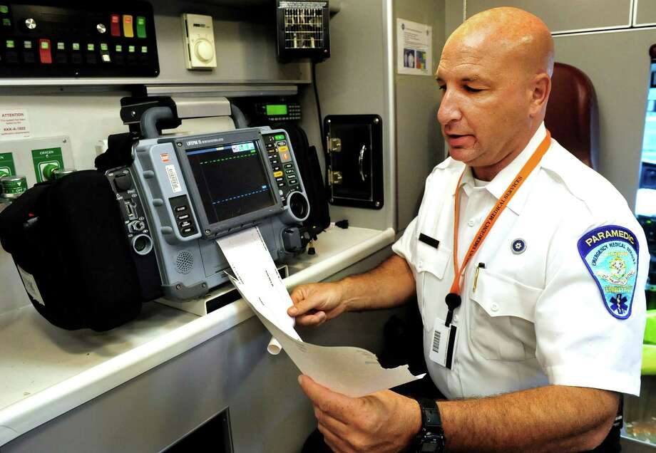 Matt Cassavechia, director of emergency medical services at Danbury Hospital, demonstrates the 12-lead EKG transmission process from an ambulance in Danbury, Conn. Monday, July 1, 2013. Photo: Michael Duffy / The News-Times