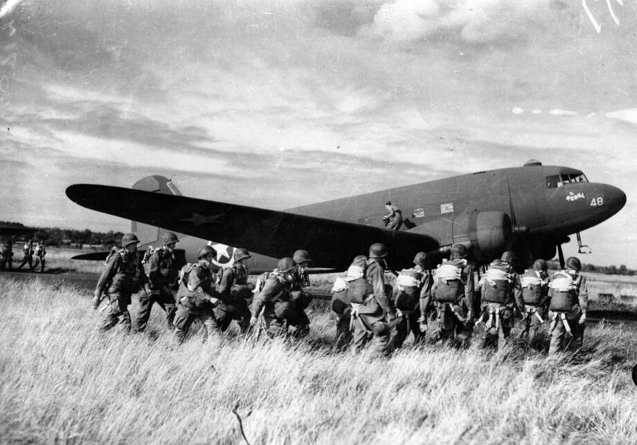 The C-47 Skytrain was the military transport version of the DC-3. Here, U.S. paratroopers prepare to board a C-47 on July 10, 1943. Photo: Keystone, Getty Images / Hulton Archive