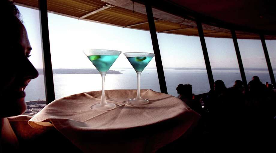 While copious amounts of water should be consumed during a heat streak, taking to the shade of a restaurant for a shaken martini or a cool draft beer is a perfect way to relax after a long day at the beach. Photo: SCOTT EKLUND / SEATTLEPI.COM