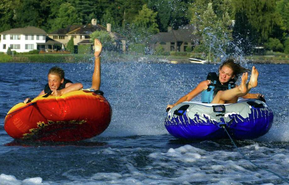 Have a boat? If floating just isn't enough, tubing with the kids is always a wild ride, especially on Lake Sammamish, pictured here. Photo: MERYL SCHENKER / SEATTLEPI.COM