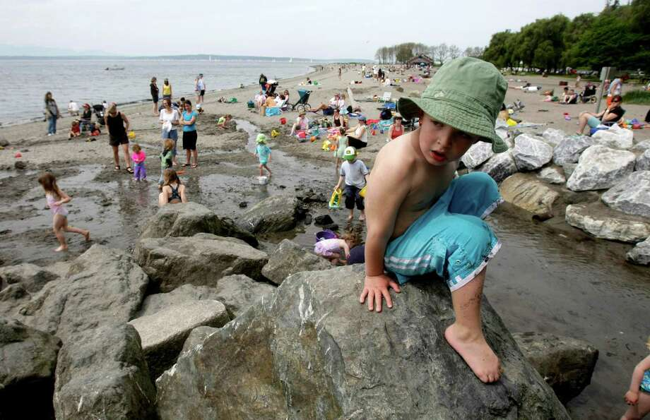 If grassy beaches aren't your thing, Golden Gardens offers a stream for kids to play in, fire pits and an ice cream stand. Photo: ANDY ROGERS, SEATTLE POST-INTELLIGENCER / SEATTLEPI.COM
