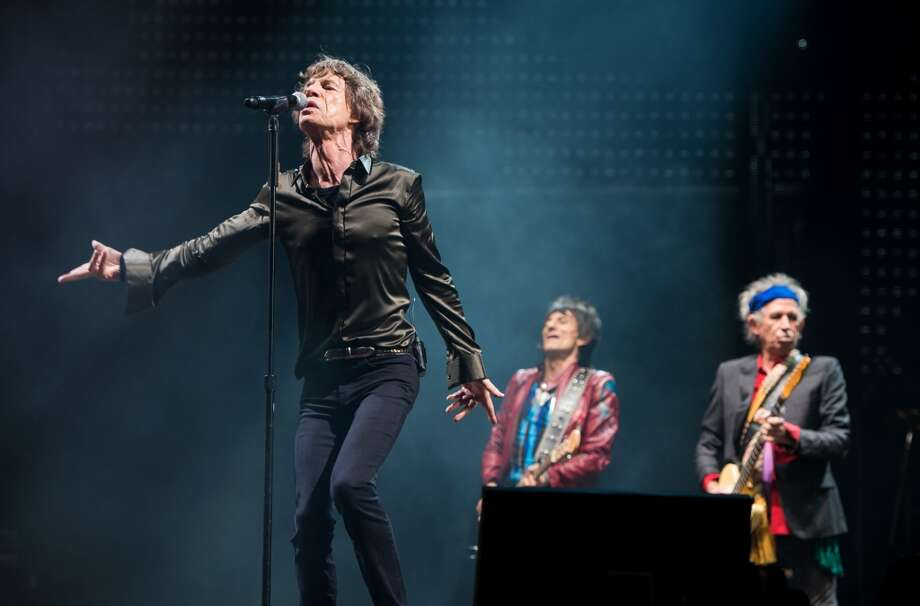 GLASTONBURY, ENGLAND - JUNE 29: Sir Mick Jagger, Ronnie Wood and Keith Richards of The Rolling Stones perform on the Pyramid Stage during day 3 of the 2013 Glastonbury Festival at Worthy Farm on June 29, 2013 in Glastonbury, England. (Photo by Ian Gavan/Getty Images)