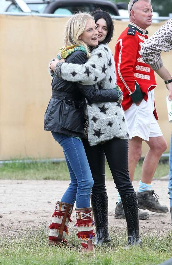 GLASTONBURY, ENGLAND - JUNE 28:  Poppy Delevingne and Pixie Geldof greet on day 2 of the 2013 Glastonbury Festival at Worthy Farm on June 28, 2013 in Glastonbury, England.  (Photo by Danny Martindale/WireImage)